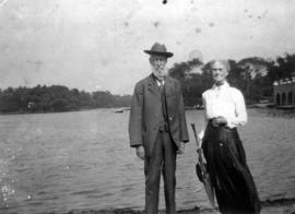 [Man and woman standing in front of lake]