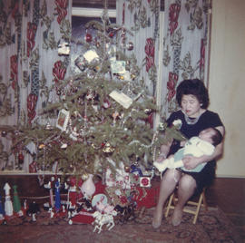 Mrs. Slim Wong with baby at Christmas