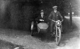 [James Crookall riding motorcycle with sidecar]