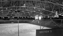 Interior of Kerrisdale Arena showing steel trusses above the rink