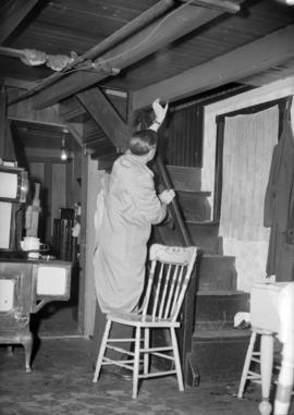 [Man inspecting the interior of 437 Powell Street, closed by the Health Department]