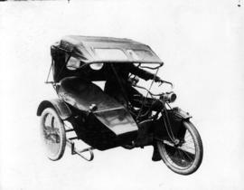 [Alfred T. Layne's motorcycle with hood up]