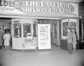 [Exterior view of the front of the Orpheum Theatre showing a movie poster above the ticket booth ...
