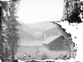 [View of Lake Louise, showing log cabin, lake, and mountains]