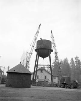 [Cranes being used to build a water tower]
