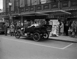 "[Open touring car parked outside the Strand Theatre as part of a promotion for ""I Remember M..."