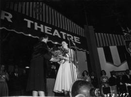 Miss P.N.E., Lynn Adcock, receiving flowers on Outdoor Theatre stage