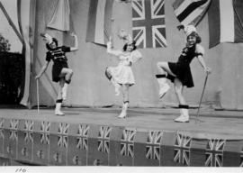 Baton twirlers on outdoor stage