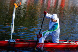 Day 20 Torchbearer 55 Steve Giles paddles the torch on his canoe on Shubenacadie Canal, Waverly, ...