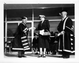 Honorary degree presented to Mrs. Nancy Hodges by Sherwood Lett and Norman MacKenzie