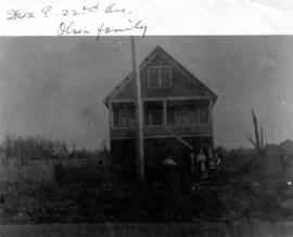 Olsen family outside home at 2848 East 22nd Avenue