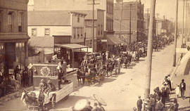 [A Labour Day parade travelling east on Cordova Street at Cambie Street]