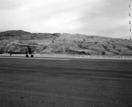 [Bi-plane landing at Kamloops Airport]