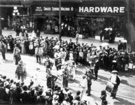 [The 600 Block of Granville Street during a Victoria Day parade]