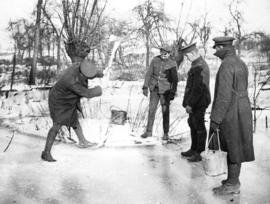 [Soldiers break ice to collect water for cooking on the Western Front]