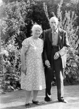 Mr. and Mrs. James L. Quiney [in the garden at] 4916 Union Street, Burnaby