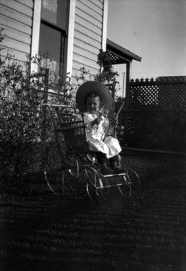 [Theodore Taylor sitting in chair with wheels in yard of home at Willow Street and 8th Avenue in ...