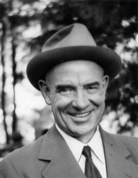 Close-up of Gerald McGeer, wearing hat