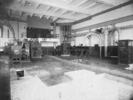 Sugar factory interior, machinery [in process of being installed?]