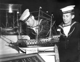 H.M.C.S. Naden sailors looking at award-winning model ship in 1951 P.N.E. Hobby Show