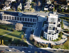 Aerial view of Vancouver City Hall and residential housing, facing east, on Cambie Street