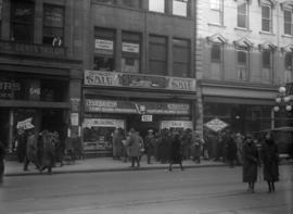 Crowd outside Share Bros. Ltd. sale, 627 West Hastings