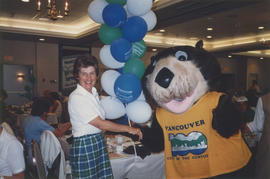 Tillicum and woman at Vancouver Centennial Women's Golf Tournament
