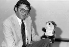 Michael Francis holds Tillicum stuffed animal