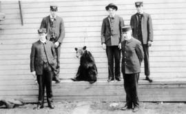 Vancouver firemen with a bear.