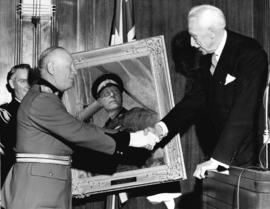 [His Excellency George P. Vanier presents Superintendent Henry A. Larson with an oil portrait]