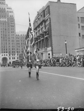Women marching with flags in 1953 P.N.E. Opening Day Parade