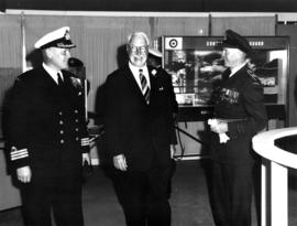 Lieutenant Governor G.R. Pearkes with R.C.N. and R.C.A.F. officers at Armed Forces exhibit on P.N...
