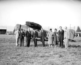 Pacific International Airways arrival of Fleetster aircraft at airport [Mayor Malkin in top hat]