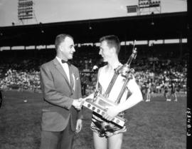 Bert Morrow presenting trophy : [to 1965 Inter High Track first place winner]