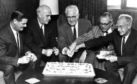 P.N.E. executives, including President H.J.C. Terry and Vice-President H. Fairbank, cutting cake