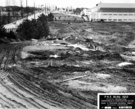 Excavation of site for P.N.E. B.C. building with Forum in background