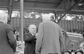 Premier of B.C., Duff Patullo awarding a medal at Brockton Point Grandstand during Golden Jubilee...