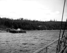 [View of Selma Park dock and beach from a navy vessel]