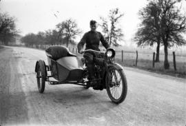 James Crookall on motorcycle with sidecar