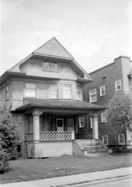 Two and a half storey house in 1300 block of West Tenth Avenue on north side of street