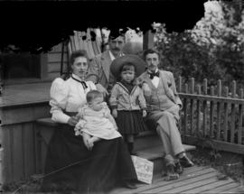 [Caple family seated on steps of house at 828 Hamilton Street]