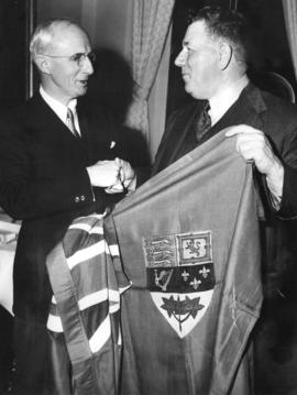 [The Right Honourable E.C. O'Dea, Lord Mayor of Sydney is presented with a flag by Mr. C. Fr...