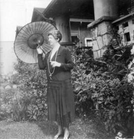 [Mrs. Gavin Johnson on the lawn of her residence on Maple Street]