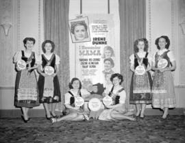 "[Women in costumes holding signs advertising the movie ""I Remember Mama"" at the Strand ..."