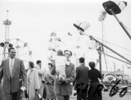 Amusement rides and fairgoers in P.N.E. Gayway