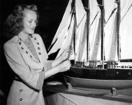 Young lady with model ship