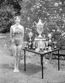 Miss Kay Cooper [in swim suit] and Trophies - Winner of Wrigley Cup 1935