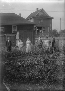 [Unidentified members of the Davidson family in a back garden]