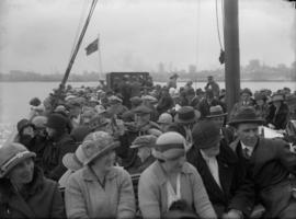 Passengers on the deck of a ship