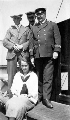 [Unidentified man, woman and crew of the Camusun]
